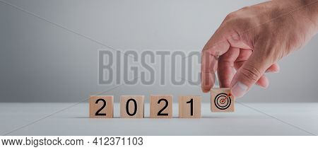 New Year 2021 And Goal Target Plan, Hand Holding Wood Cubes With New Year 2021 And Goal Or Target Ic
