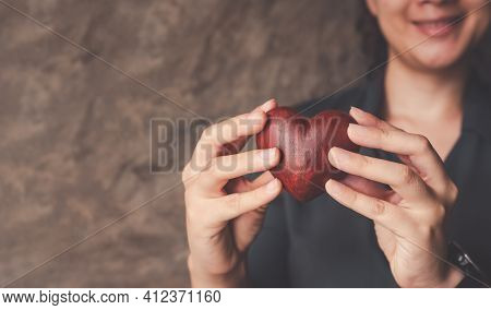 Female Hands Holding Red Heart, World Mental Health Day And World Heart Day, Life And Health Insuran