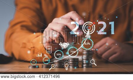 Saving And Investment Plan Business Growth In Year 2021 Concept. Businessman Plan And Increase Of Po