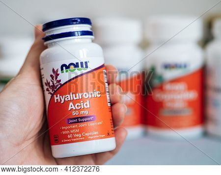 Moscow, Russia - March 09, 2021: Jar With Hyaluronic Acid Capsules In Female Hand And Others Nutriti