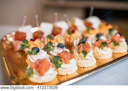 Light Snacks In A Plate On A Buffet Table. Assorted Mini Canapes, Delicacies And Snacks, Restaurant
