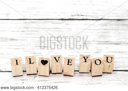 Wood Type Stamps With The Word I Love You Printed On A Table
