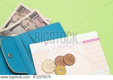 Leather Wallet With Ten Thousand Japanese Yen And Passbook. Translation: Year, Month, Day, Descripti