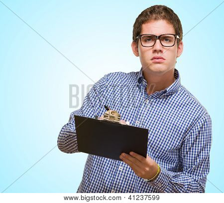 Businessman Writing On Clipboard against a blue background