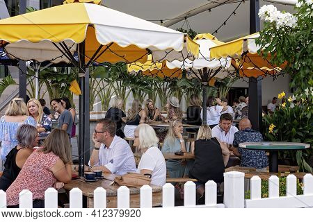 Brisbane, Queensland, Australia - March 2021: People Dining Outdoors At A City Restaurant