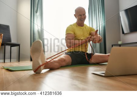 Coach Siting On The Twine And Showing The Super Gesture In The Laptop. Sporty Man 46 Years Old Smili