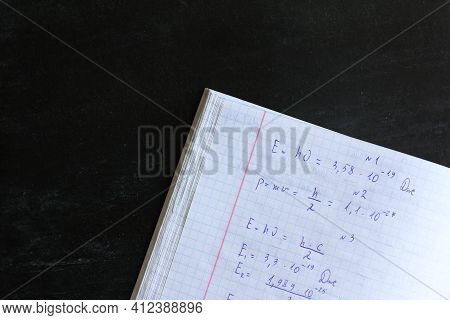 Copybook Abstract With Solving Physics Problems On A Black Board Background. Exam Preparation