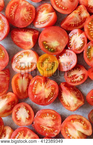 Many Red Tomato Slices On Baking Paper Top View. Cooking Vegetables