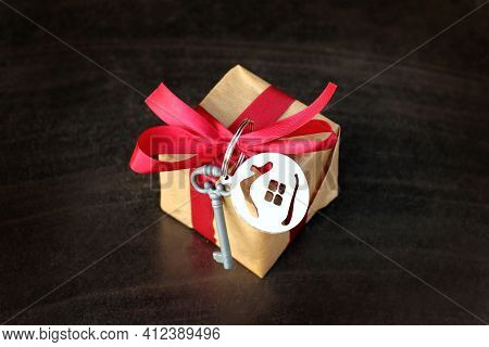 Gift Idea With Key Symbol And House In The Shape Of A Ball For Tree Decoration On A Dark Background.