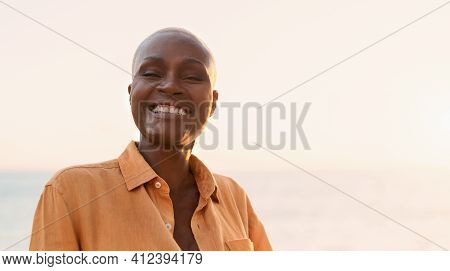 Senior African Woman Having Fun During Summer Holidays - Happiness And Elderly People Lifestyle Conc