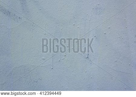 Roughly Painted Wall With Dark Blue Paint. Evidence Of Blue Paint. Beautiful Abstract Grunge Decorat