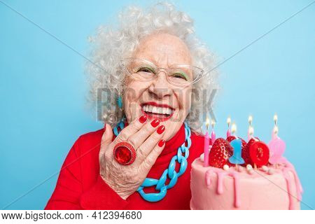 Positive Good Looking Senior Woman Smiles Toothily Has Good Mood Enjoys Festive Occasion Holds Big T