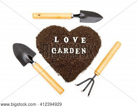 Creative Arrangement Of Garden Hand Tools Around A Heart Shaped Pile Of Soil With Lettering Love Gar