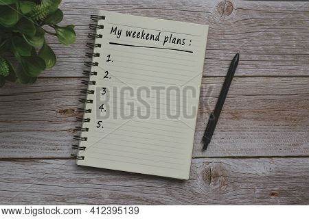 Text On Notepad On Wooden Table - My Weekend Plans