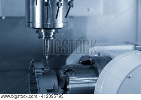 The 4-axis Simultaneous Machining Center Cutting The Motorcycle Gear Case Parts On The  Rotary Table