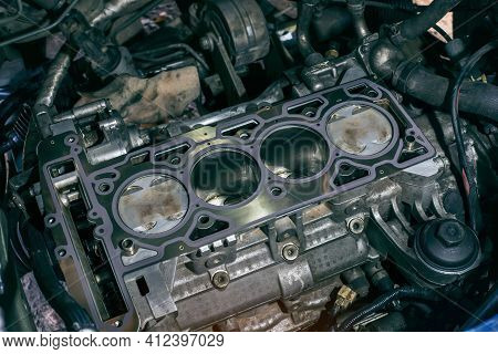 Auto Mechanic Working On Car Engine In Mechanics Garage. The Cylinder Block. Automotive Part,machine
