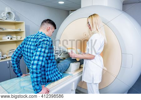 Radiologist Prepares The Patient For An Mri Knee Examination