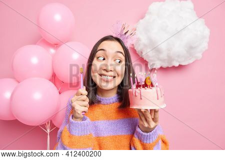 Glad Woman Looks With Temptation At Appetizing Sweet Birthday Cake But Cares About Teeth Holds Tooth