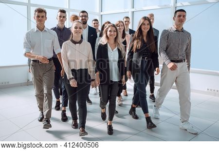 group of ambitious young people enter a new office