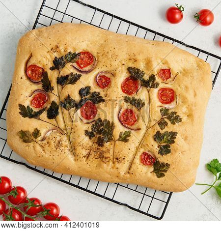 Food Art. Whole Focaccia, Pizza, Cut Flat Bread With Vegetables On Grid, Tradition Italian Cuisine.