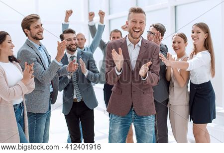 happy group of creative young business people applaud