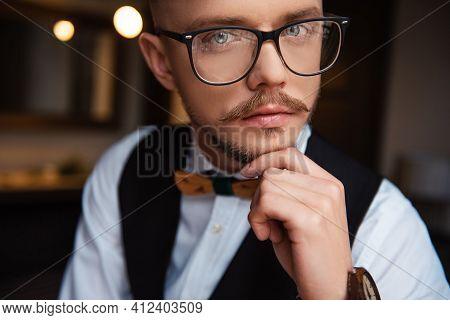 Confident Bearded In Eyeglasses Posing At Hotel Room