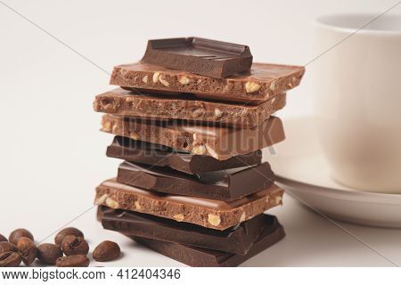 Chocolate Tower. Stack Of Chocolate Pieces. The Chunks Of Broken Chocolate. Background With Chocolat