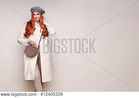 Young Elegant Woman In Trendy White Coat. Blond Hair, Gray Beret, Isolated Studio Shot. Fashion Autu