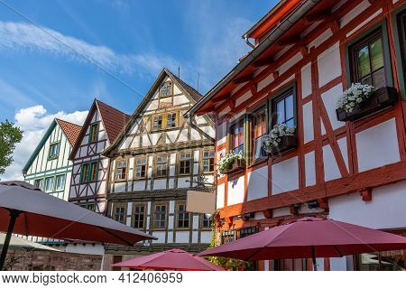 Facades Of Half-timbered Houses In  Schmalkalden, Thuringia And Parasols In The Foreground