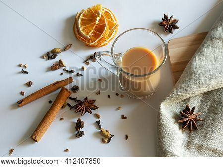 Traditional Indian Masala Tea With Spices. Anise, Star Anise, Cinnamon, Pepper, Milk. White Backgrou
