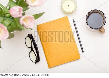 Workspace With Modern Notebook, Stationery, Cup Of Coffee On White Table Top View. Feminine Concept,