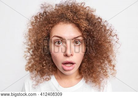Headshot Of Startled Speechless Woman Keeps Jaw Dropped Notices Something Shocking Stands In Stupor
