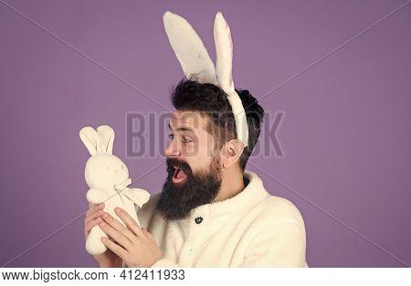 Soft And Tender. Guy With Bunny Or Rabbit Ears On Violet Background. Enjoy Tenderness. Childhood Mem