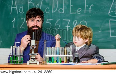 I Love Study In School. Teacher And Pupil Boy In Chemical Laboratory. Chemical Invention. Study Chem