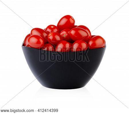 Fresh Ripe Cherry Tomatoes In Dark Bowl Isolated On White Background