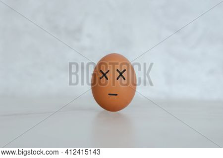 Egg, One Egg On The Table. Drawing Of Face, Eyes And Mouth On An Egg