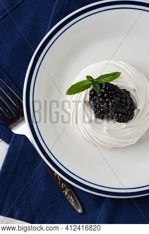 Top View Of Blackberry Meringue Nest With Mint