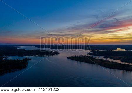 Aerial View Of Big Creek Lake In Semmes, Alabama At Sunset