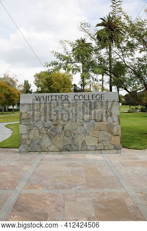 March 12, 2021 - Whittier, California: Whittier College. Large Rock Wall with WHITTIER COLLEGE Sign at the entrance to campus. Closed due to Coronavirus Pandemic. Editorial Use Only.