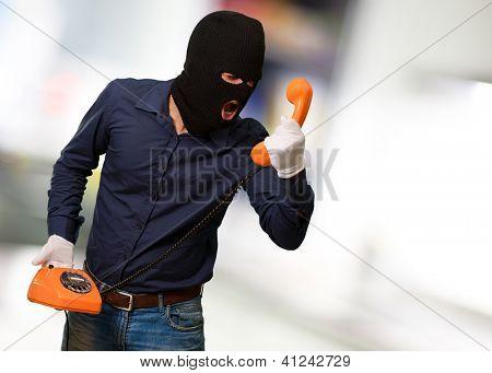Burglar Man Shouting On Telephone, Indoors