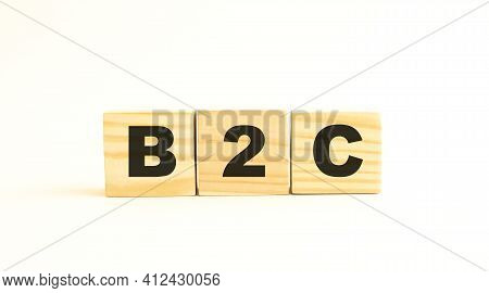 The Word B2c. Wooden Cubes With Letters Isolated On White Background. Conceptual Image.