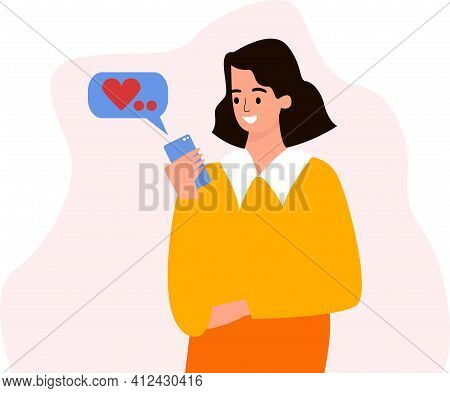 A Girl With A Phone In Her Hands. Correspondence In The Phone, A Message To The Phone. The Girl Rece