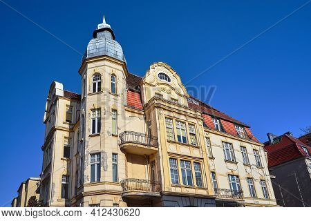 Facade With Tower And Balconies Of Historic Tenement Houses In The City Of Poznan