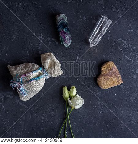 Flat Lay Magic Composition With Crystals, Pagan Bag And Rose Flowers. Esoteric And Pagan Rituals, Wi