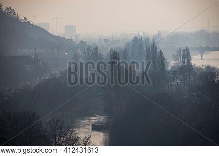 Podoli Quarter In Winter Haze By Moldau River In Prague, Czech Republic