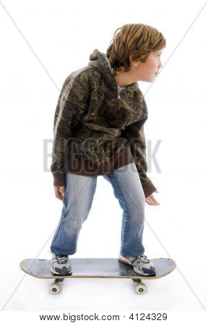 Front View Of Child Standing On Skateboard