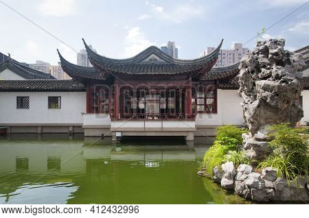 The Confucius Hall To Listen To Rain Overlooking The Sky And Cloud Reflection Pool At The Shanghai C