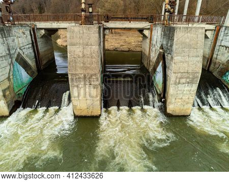 Aerial Drone View, Small Dam Over Olt River At Springtime In Transylvania, Romania.