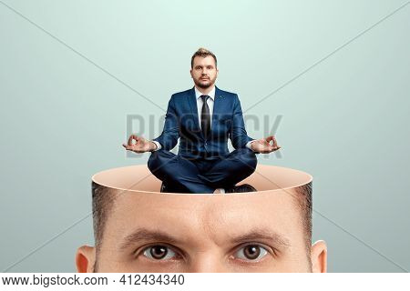 Rest For The Brain, Close-up Of A Man's Head Inside A Man In A Business Suit Sitting In The Lotus Po