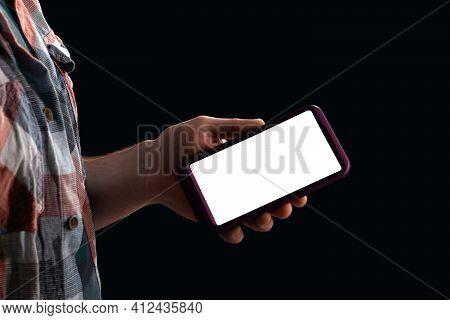 Mobile Phone In The Hand Of A Teenager, Mocap Copy Space, Hand In The Shade.
